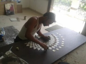 onsite marble inlay work on wooden door