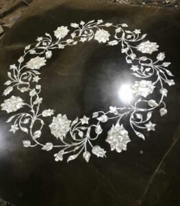 pure white MOP inlay work on wooden tabletop