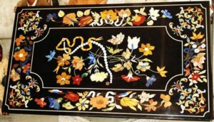 classic pietra dura work on black marble tabletop