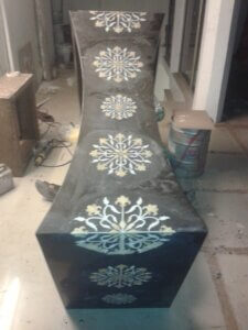 luxurious inlay work on black marble tabletop