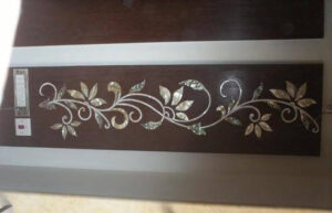 Green abalone mop inlay work design on wood