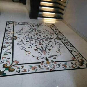 multi coloured stones inlay on marble flooring